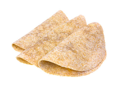 tortillas: Three whole wheat tortillas folded atop a white background