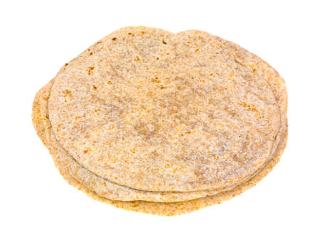 tortillas: Several whole wheat tortillas in a stack on a white background