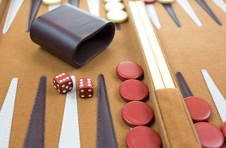 Close view of a roll of two red sixes with shaker backgammon game