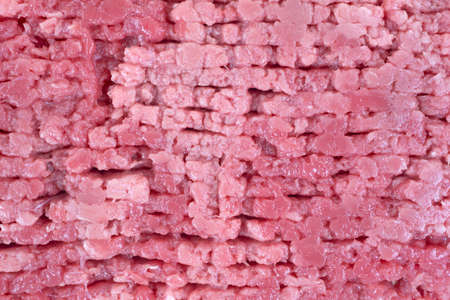 cubed: A very close view of raw beef cubed steak.