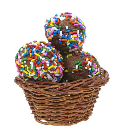 jimmies: Several fresh donut holes sprinkled with colorful jimmies in a small basket on a white background. Stock Photo
