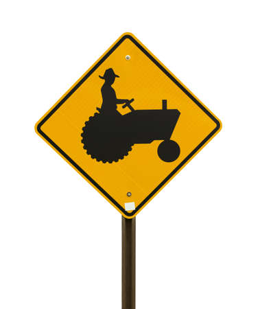 tractor warning sign: A bright yellow farm tractor sign on a white background  Stock Photo