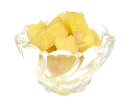 pepino: A small glass dish with sliced pepino melon on a white background