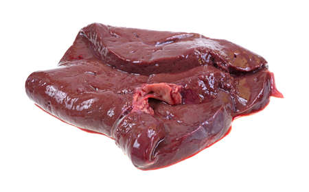 A slice of raw beef liver that is folded on a white background  Imagens