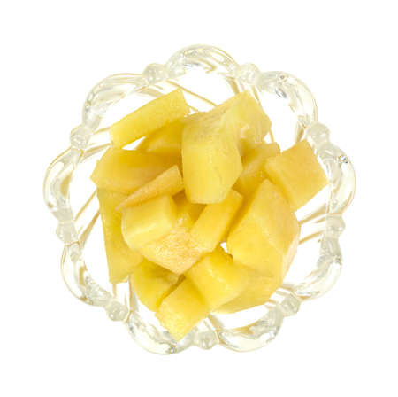 pepino: Top view of a small leaded glass dish filled with slices of pepino melon on a white background  Stock Photo