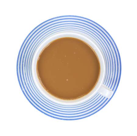 Vista superior de una vieja taza y un platillo lleno de café caliente francés vainilla latte sobre un fondo blanco. Foto de archivo - 15688605
