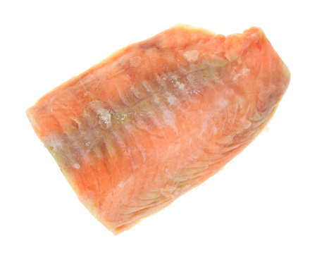 A single fillet of wild caught salmon still frozen on a white background Stock Photo - 15869589