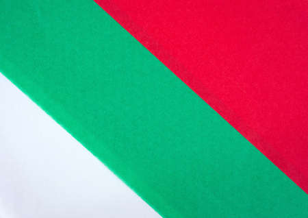 tissue paper: A very close view of holiday red green and white tissue paper