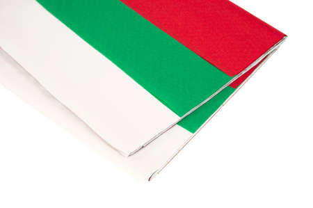 tissue paper: Ends of red white and green holiday tissue paper on a white background