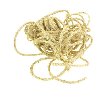 mess: A sisal rope that is a tangled mess on a white background  Stock Photo