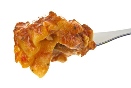 A fork with lasagna on a white background  Stock Photo