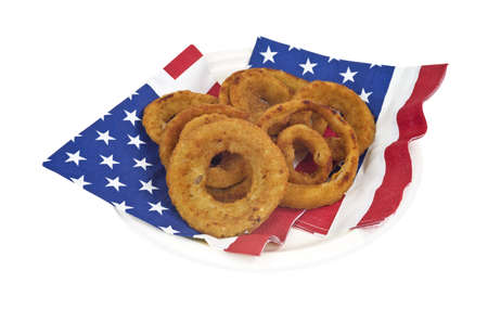 A serving of fresh onion rings on American flag motif napkins and paper plate