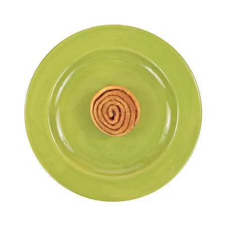 A single small cinnamon bun on a green plate Stock Photo - 17241164