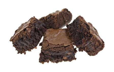 chocolaty: Several home made chocolate brownies on a white background