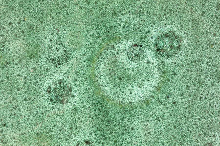Close view of a mottled and stained vintage green ceramic surface  Imagens