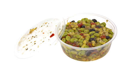 A plastic disposable container and lid filled with edamame salad  Banque d'images