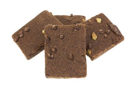 Several chocolate fudge brownies with chips and nuts on a white background. Stock Photo