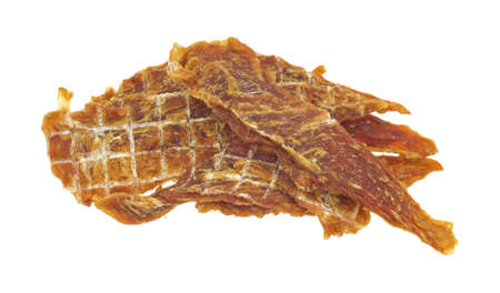 A small group of dehydrated chicken jerky for dog treats on a white background.