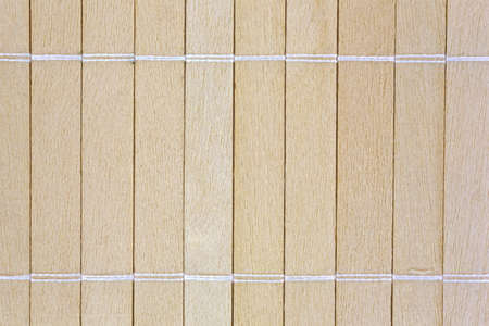 A very close view of small wood slats that have been joined together with string. Banco de Imagens
