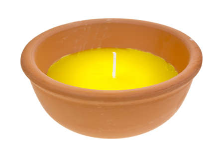 A large citronella candle in a red clay bowl on a white background.