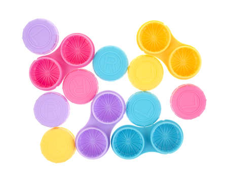 contact: Several contact lens storage cases with covers on a white background.