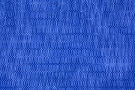 Close view of a wrinkled water resistant blue nylon fabric. Stock Photo