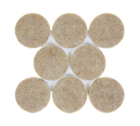 white backing: A group of new felt surface protectors on a white background.
