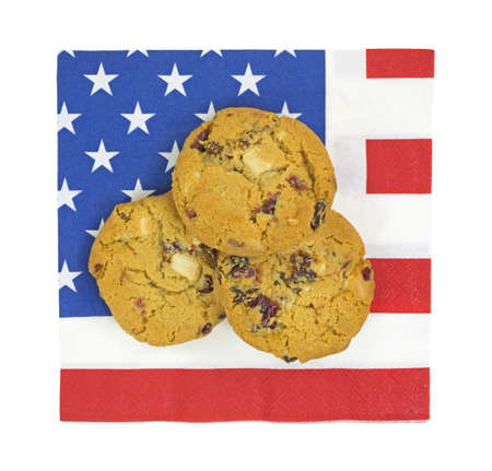 Three cookies atop a paper napkin with the American flag motif. Stock Photo - 20721782