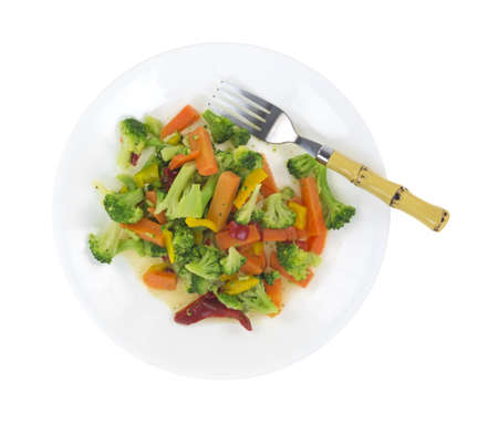 fibber: Top view of a healthy vegetable meal on a white plate with fork. Stock Photo