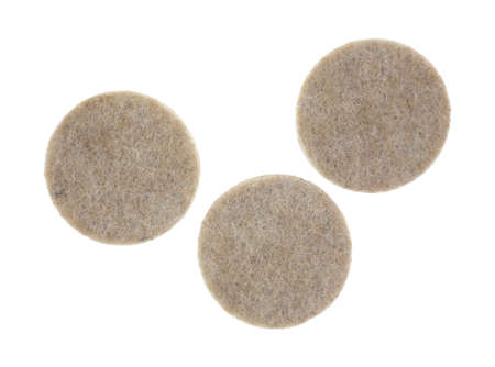 Three felt surface protectors on a white background.