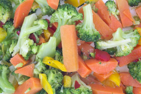 fibber: A very close view of assorted cooked vegetables on a plate.