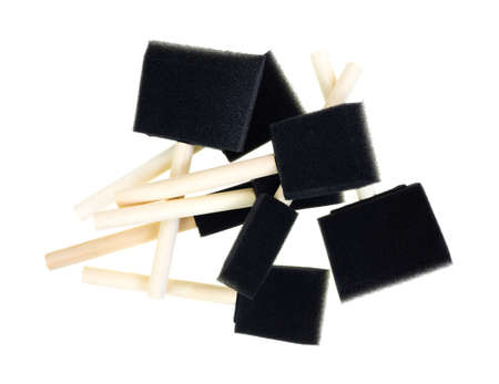 Top view of a group of new foam paint brushes with wood handles on a white background. Stock Photo - 21020426