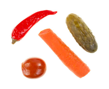 Top view of a pickled red pepper, pickle, carrot and tomato on a white background.