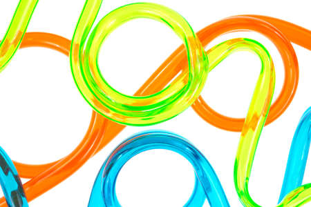 A very close view of green orange and blue tubing on a white background. Imagens