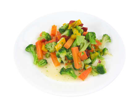 fibber: A small dinner plate with a large serving of healthy assorted vegetables in olive oil on a white background.
