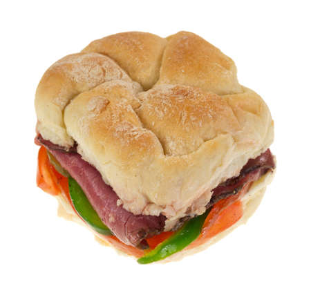 A bulky roll sandwich with roast beef and vegetables on a white background  photo