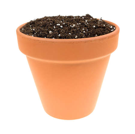 castings: A clay pot filled with organic potting soil on a white background. Stock Photo
