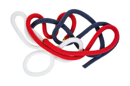A small jumble of short pieces of red white and blue rope.