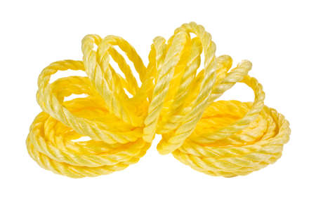 A coil of yellow rope that has been opened to show loops in center on a white background. Stock Photo