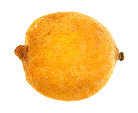 overly: A lemon that is shriveling and rotting on a white background.
