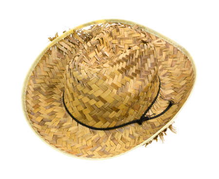 throwaway: An old woven straw hat that is showing ragged wear