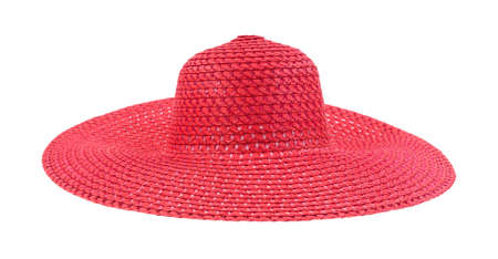 A large floppy red straw hat for ladies Stock Photo
