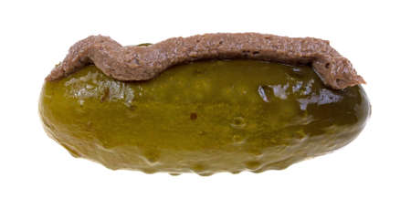 A single large dill pickle with anchovy paste applied on top. Stock fotó