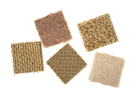 Braided and plush carpet samples on a white background. photo