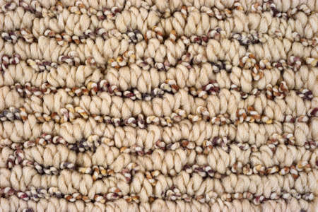 floor covering: A very close view of a thick braided carpet.
