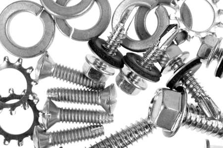 one sheet: A very close view of lock washers with assorted metal screws on a white background. Stock Photo