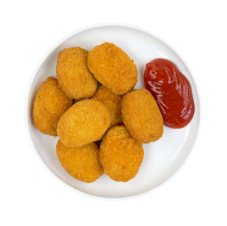A small serving of cooked breaded chicken pieces with ketchup on a small plate