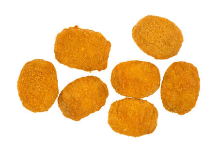 Top view of several cooked breaded chicken nuggets on a white background  Stock Photo