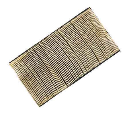 An air filter for cars that is clogged with dirt and dust on a white background  photo