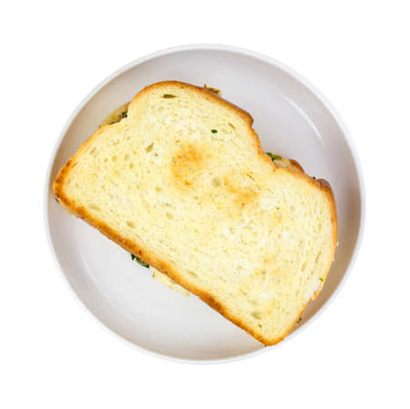 toasted sandwich: Top view of a freshly toasted sandwich on a small white plate